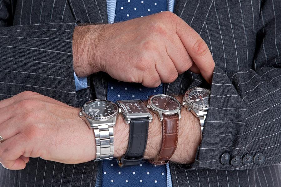 bigstock-Businessman-with-four-wrist-wa-51535273