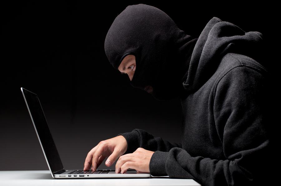 bigstock-Computer-hacker-in-a-balaclava-53815411