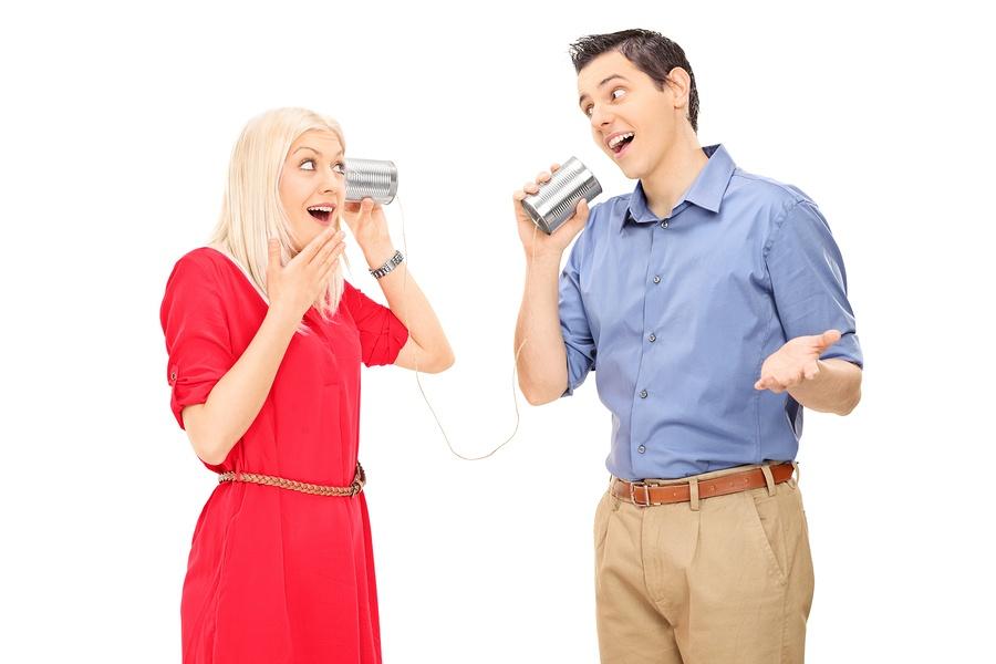 bigstock-Man-and-woman-talking-through--63426832